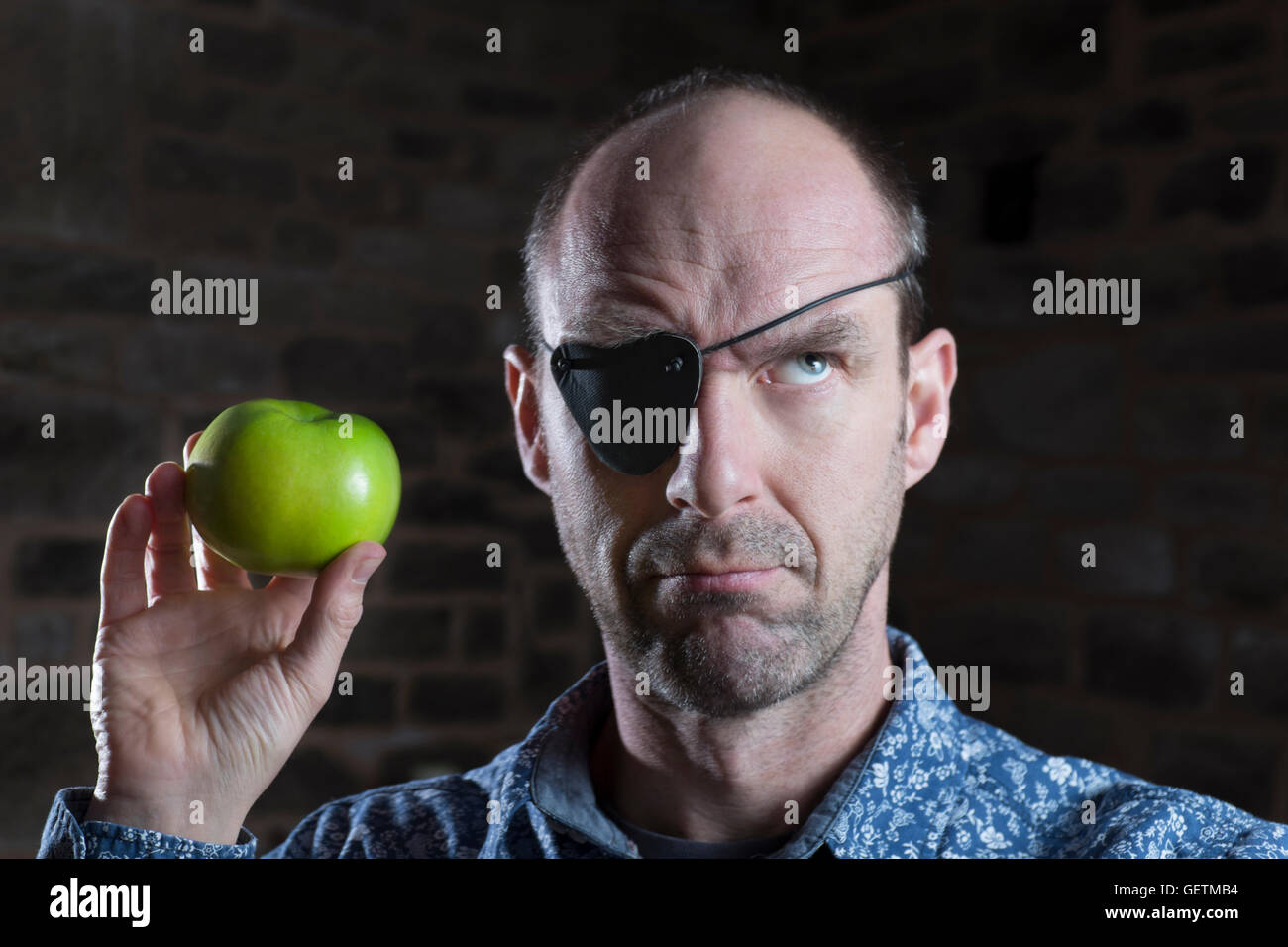 Apple eye patch confusion. - Stock Image