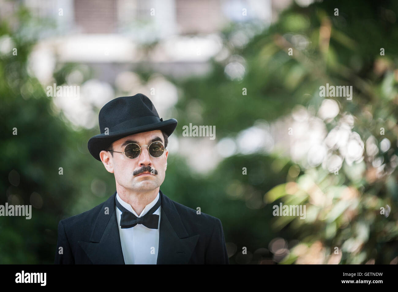Tristan Langlois who the resident master of ceremonies at the Chap Olympiad prepares himself to take the stage to - Stock Image