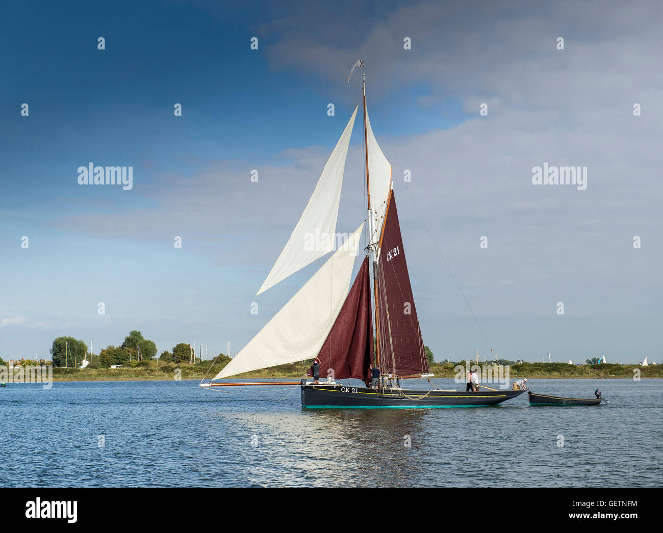 An historic gaff rigged East Coast fishing smack on the Blackwater River in Essex. - Stock Image