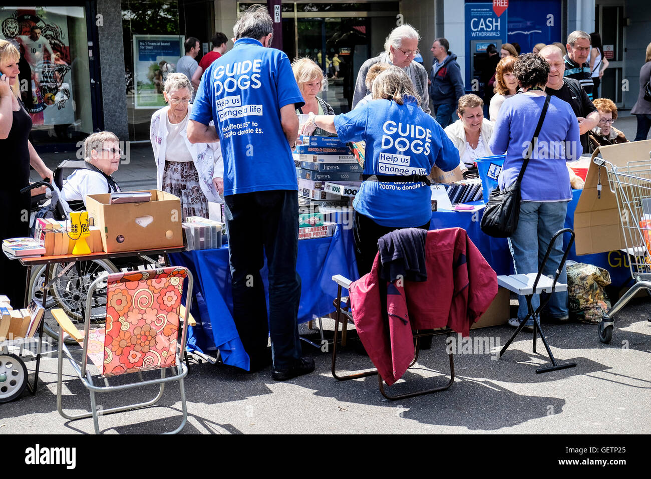 Volunteers raising funds for Guide Dogs for the Blind. - Stock Image