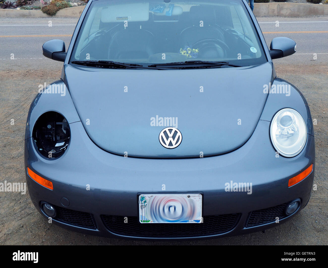 VW Bug Beetle Missing one Headlight - Stock Image