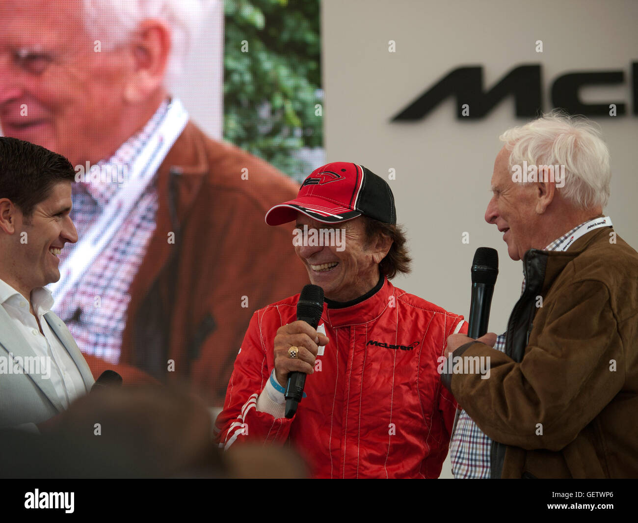 2016 Goodwood Festival of Speed UK - Emerson Fittipaldi speaking on the McLaren stand with Gordon Coppuck Stock Photo