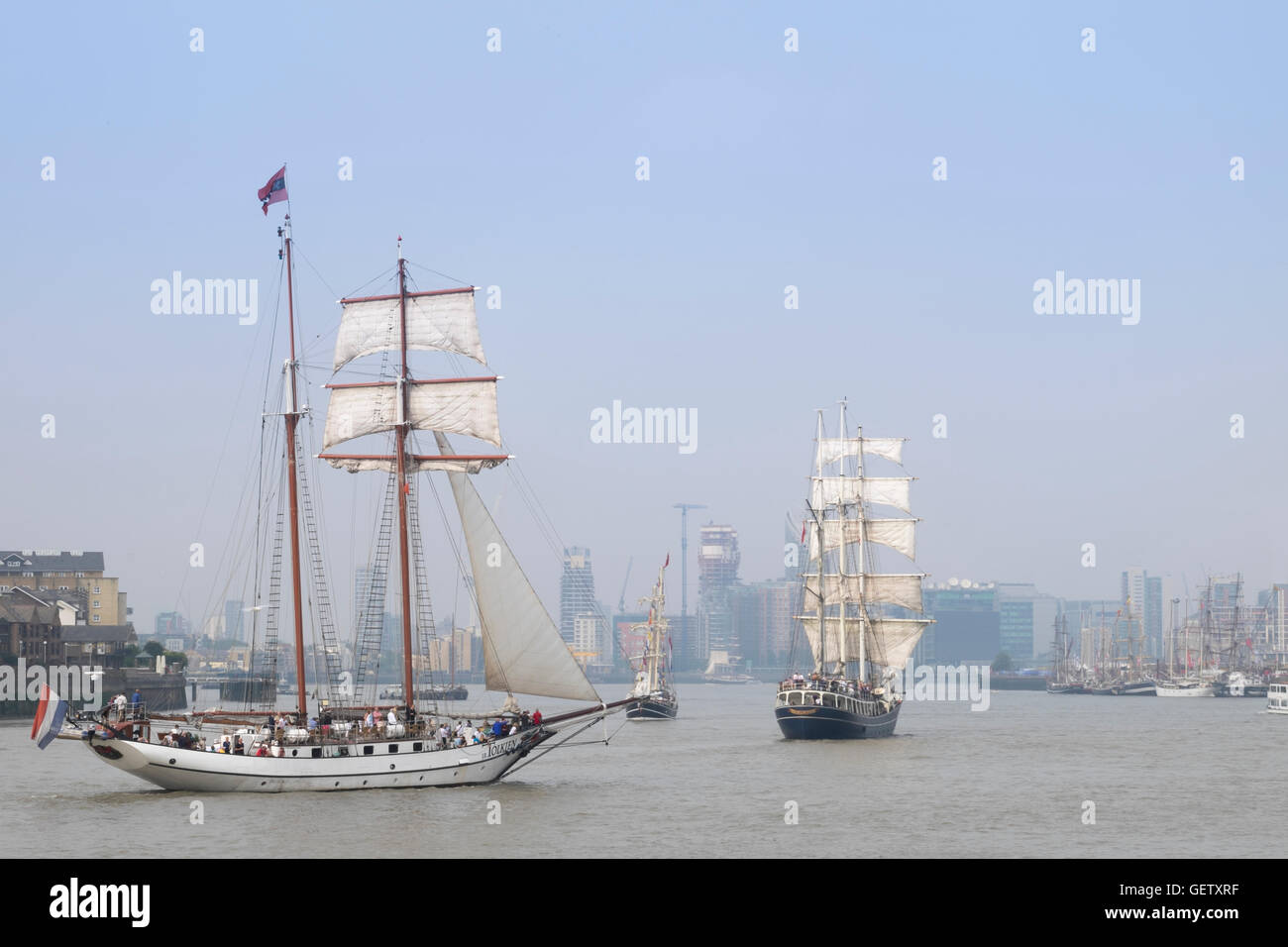 Sailing ships taking part in the 2014 London Tall Ships festival. - Stock Image