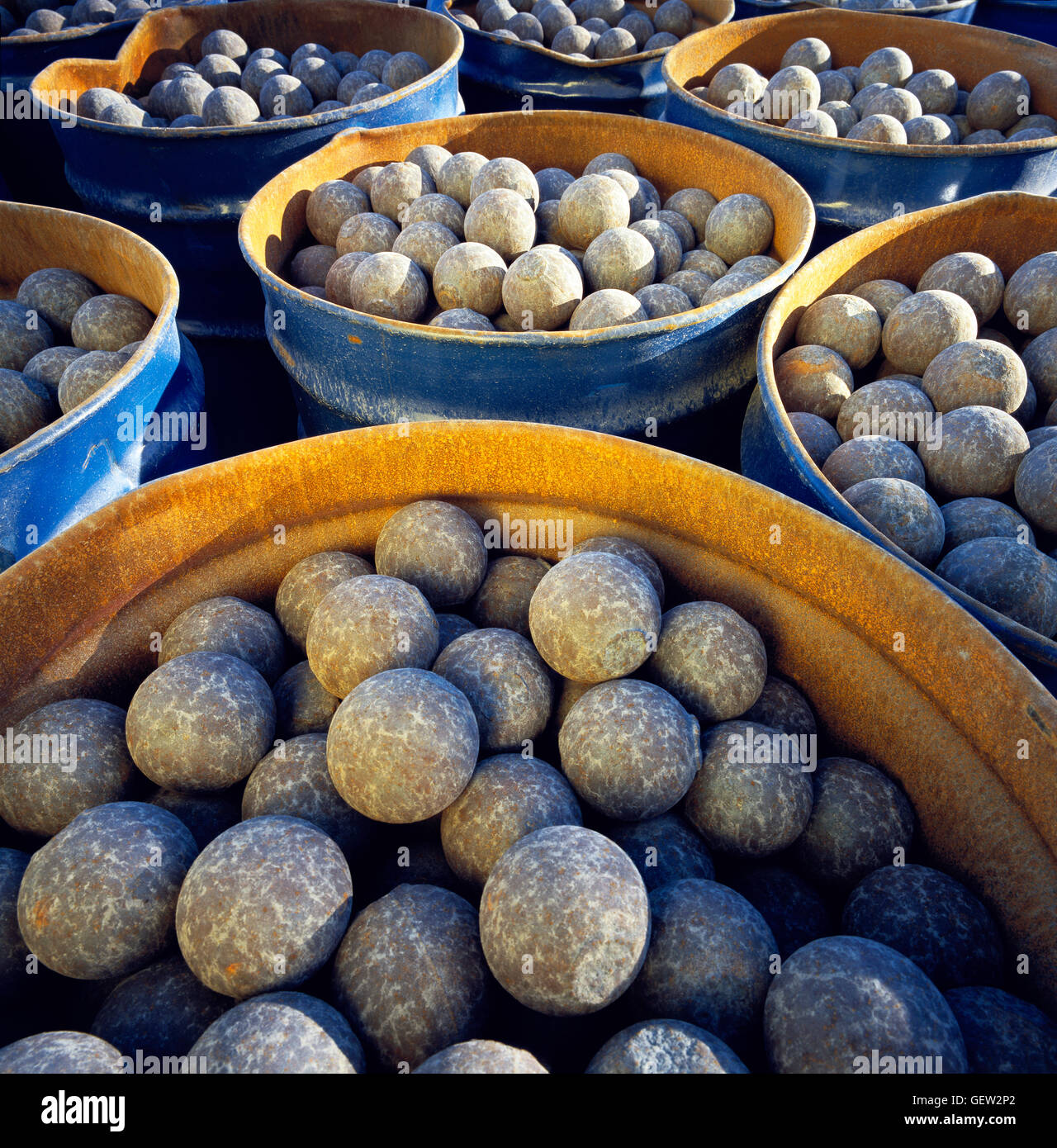 Roller balls used in cement plant machinery to grind down raw materials in the manufacturing of cement. - Stock Image