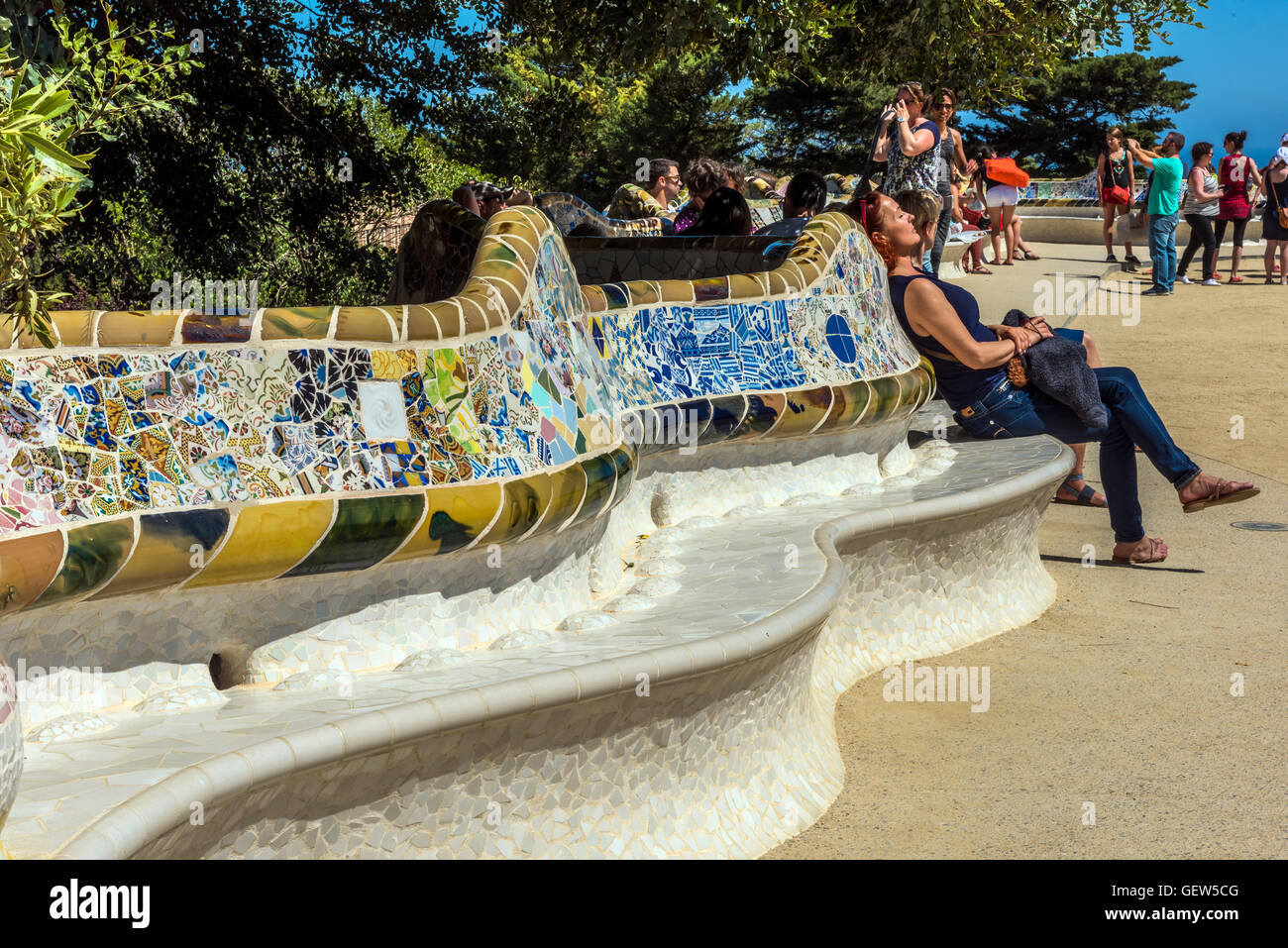 Multicolored mosaic bench at Park Guell, Barcelona, Catalonia, Spain - Stock Image