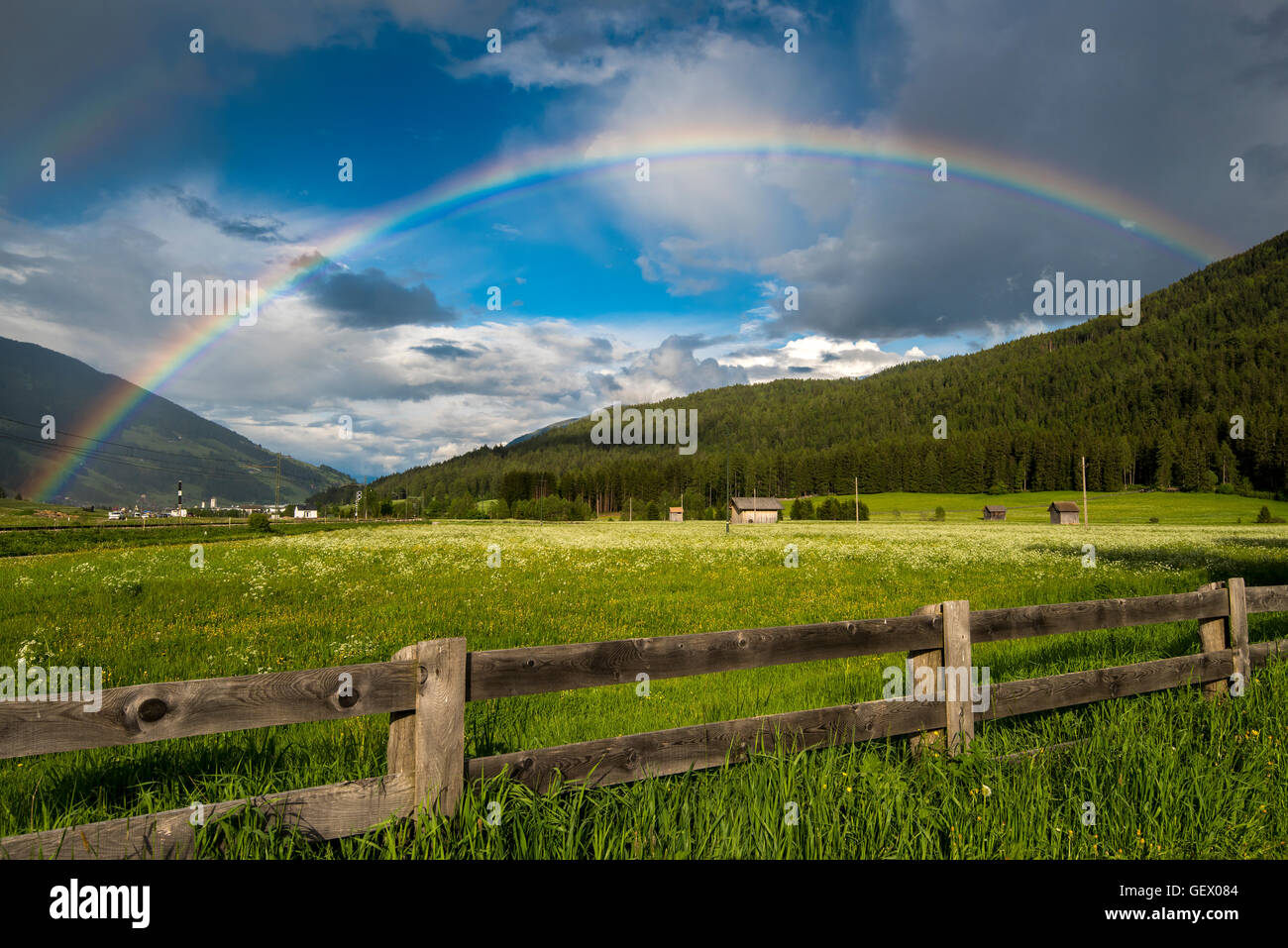 Mountain landscape with rainbow in Val Pusteria or Pustertal valley, South Tyrol, Italy - Stock Image
