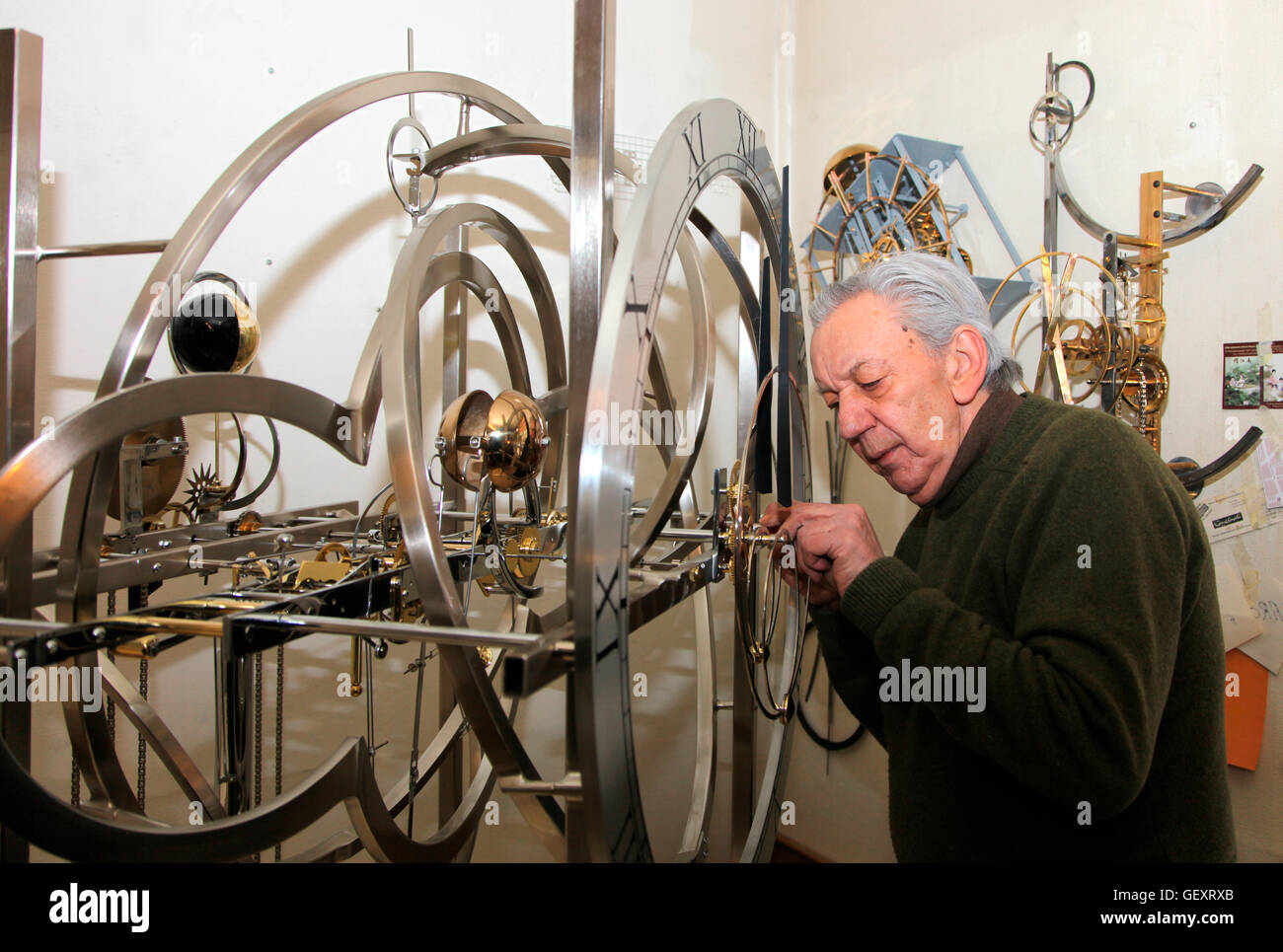 Master Swiss clockmaker Jean Kazez in his Geneva workshop working on a clock bound for Clochard in New York. - Stock Image