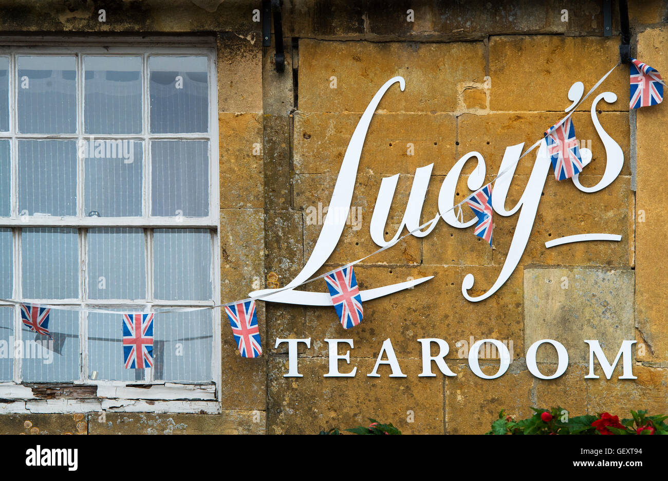 Lucys tearoom sign and union jack bunting. Stow on the Wold, Cotswolds, Gloucestershire, England Stock Photo
