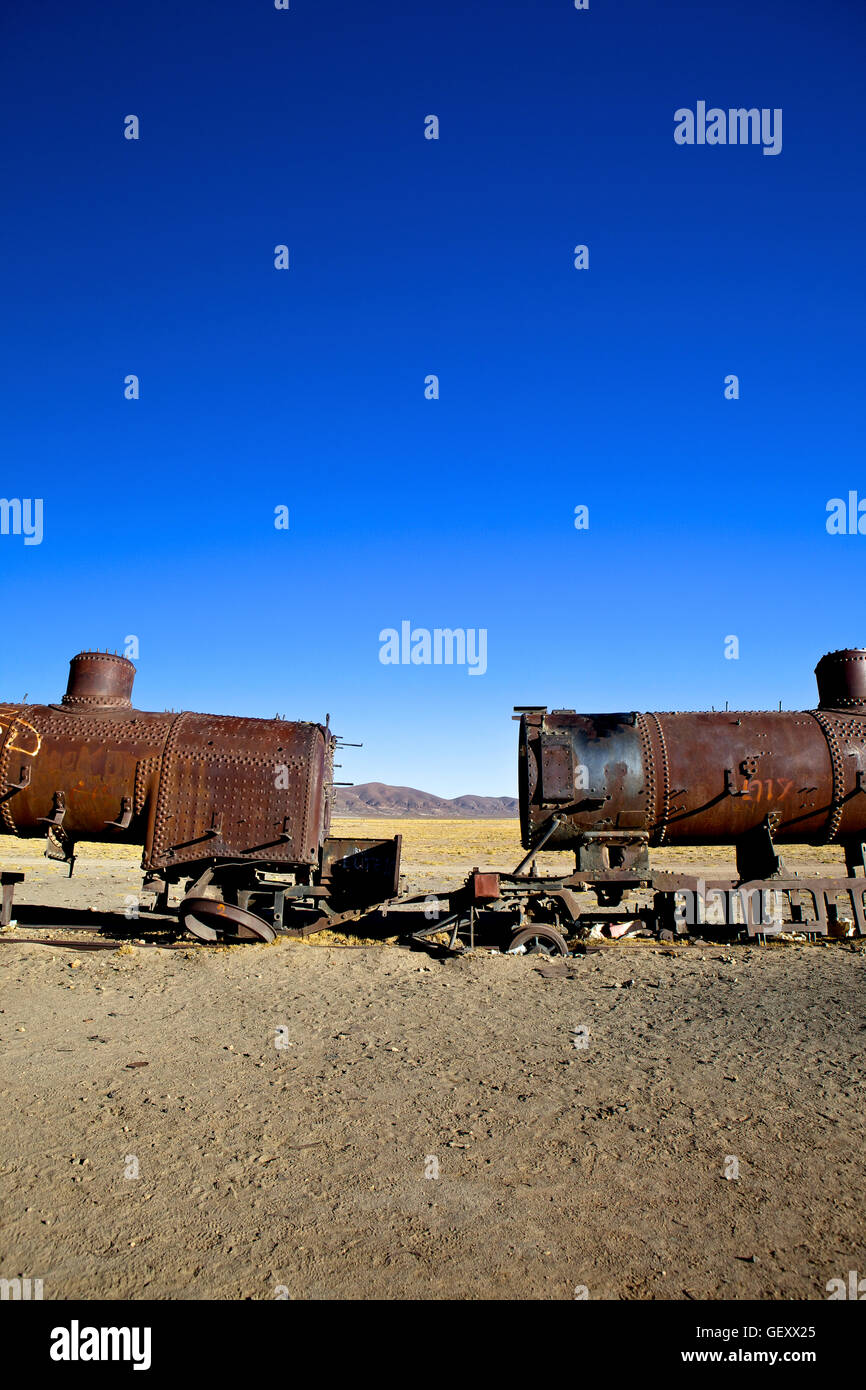 Rusting old steam locomotives at the train cemetery in Uyuni in Southwest Bolivia. - Stock Image