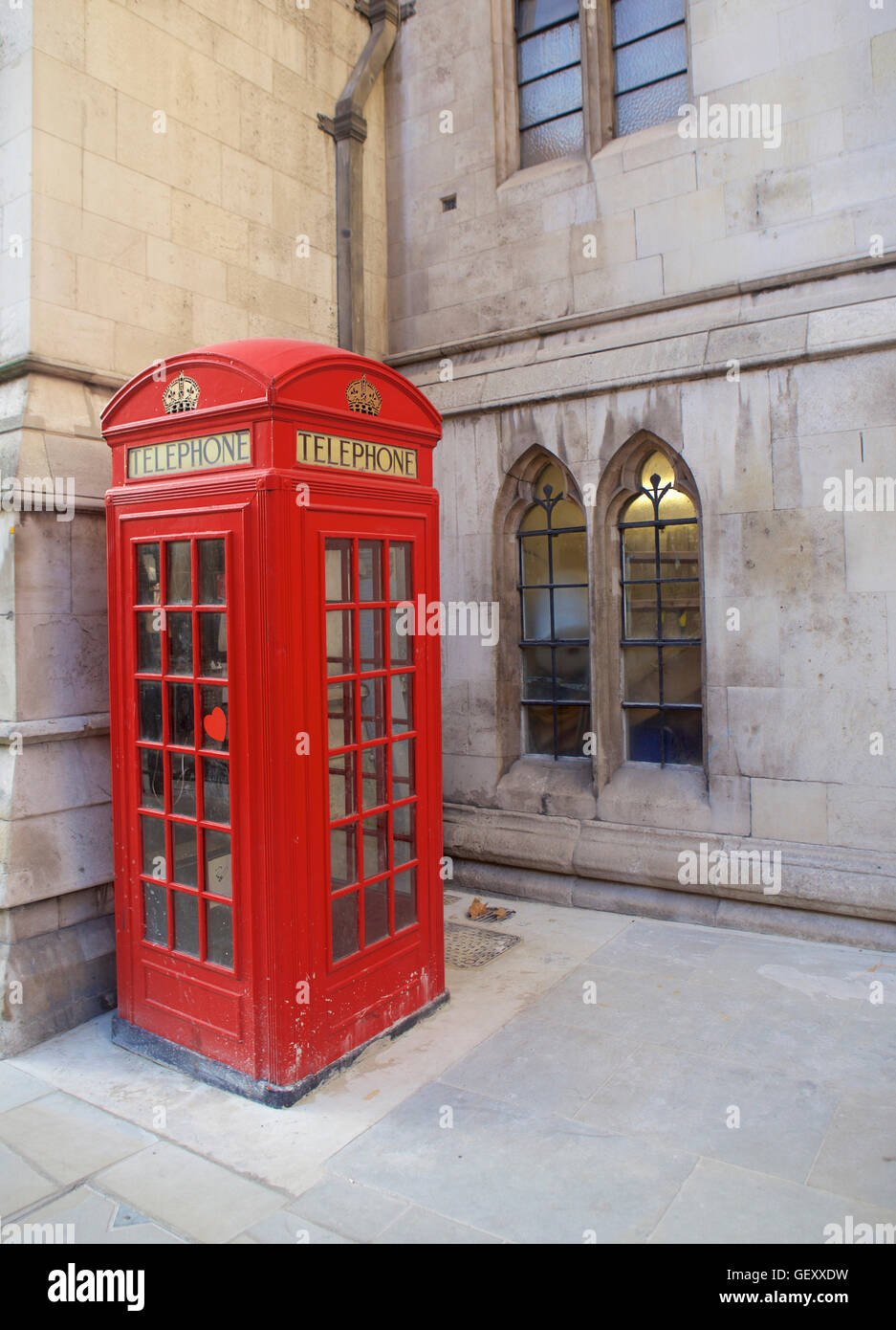 Red telephone booth designed by Sir Giles Gilbert Scott in Fleet Street. - Stock Image