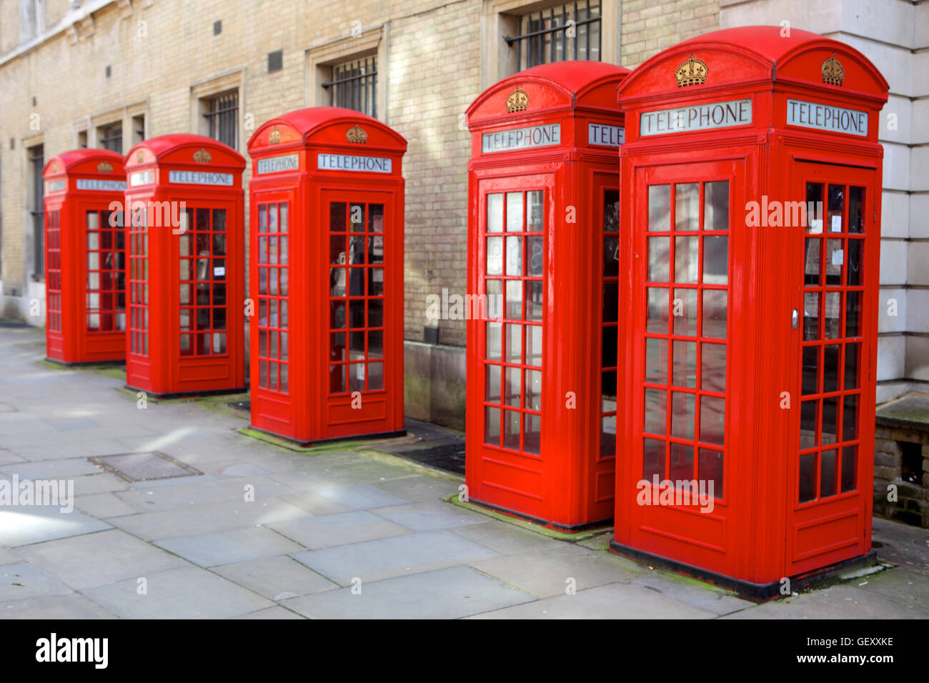 Row of red telephone booths design by Sir Giles Gilbert Scott in a street near Covent Garden. - Stock Image