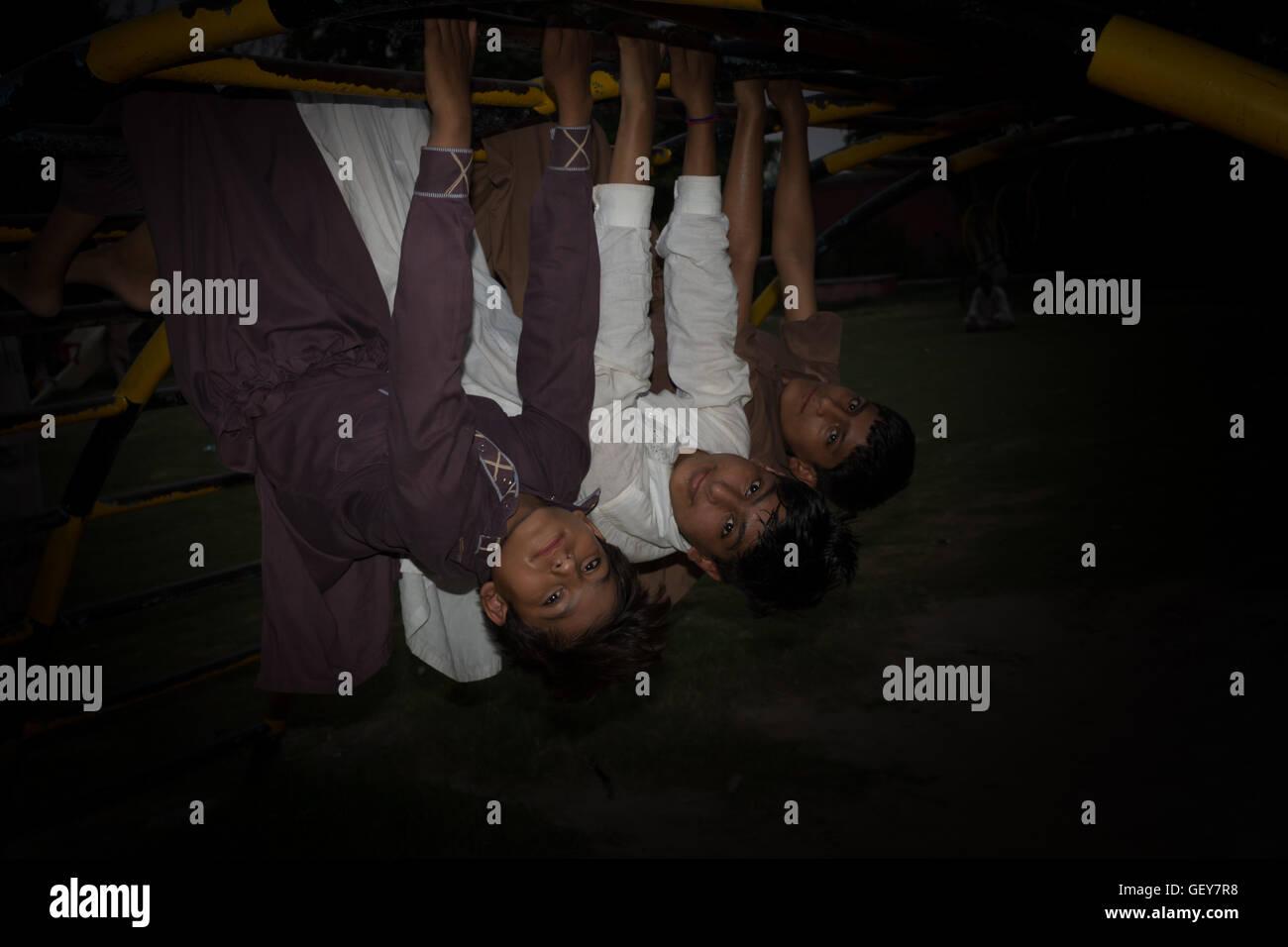 kids hanging upside down Stock Photo