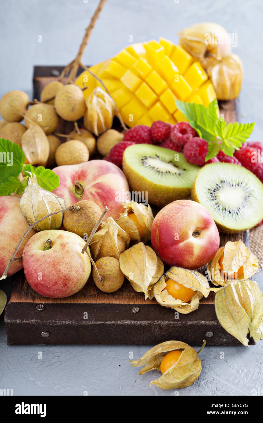 Fresh and ripe tropical fruit board - Stock Image