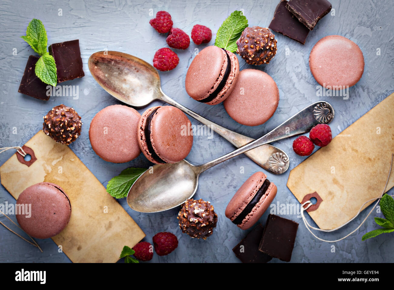 Chocolate french macarons with ganache filling - Stock Image