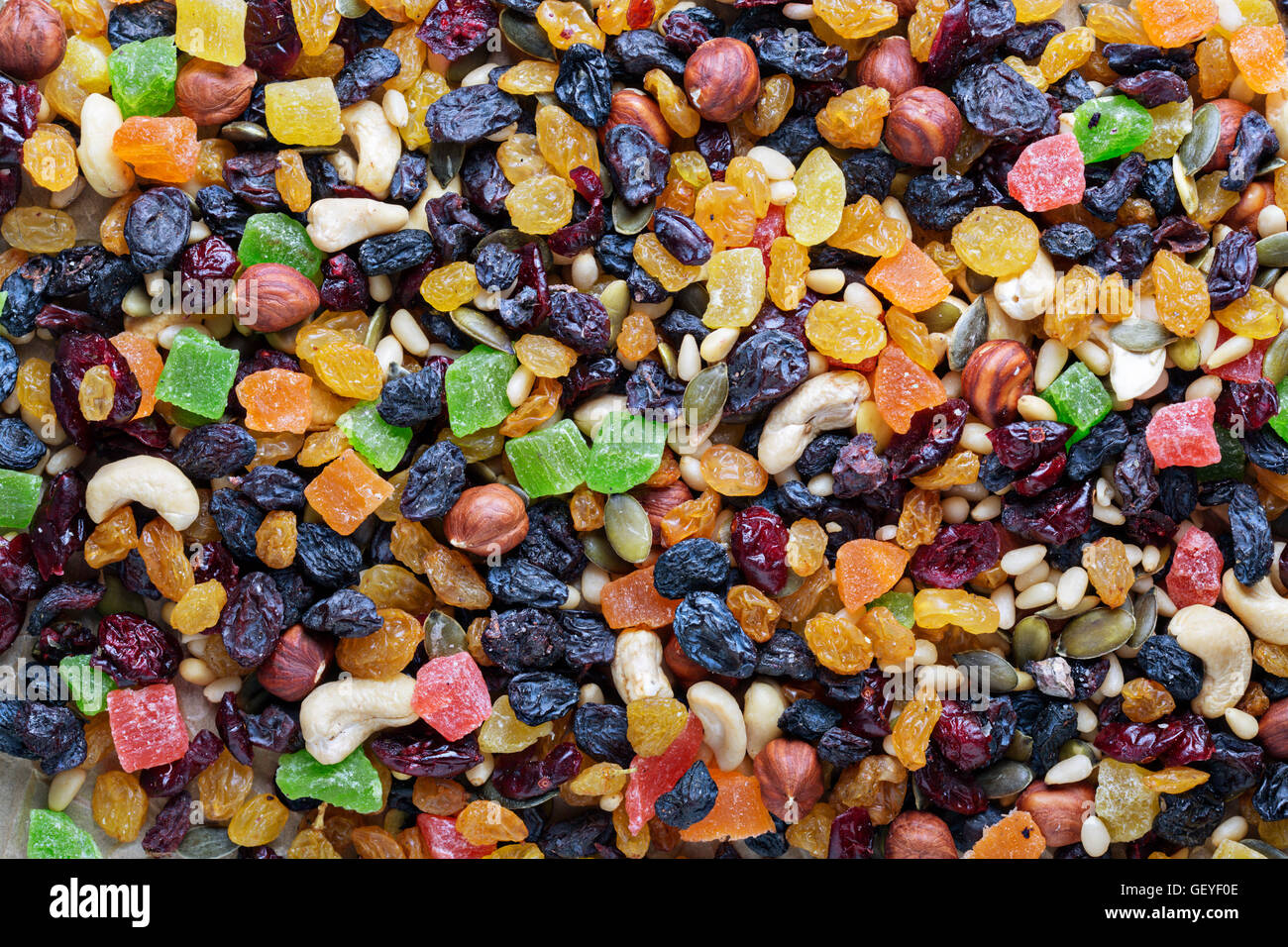 Mixed nuts and fruits in a bowl - Stock Image