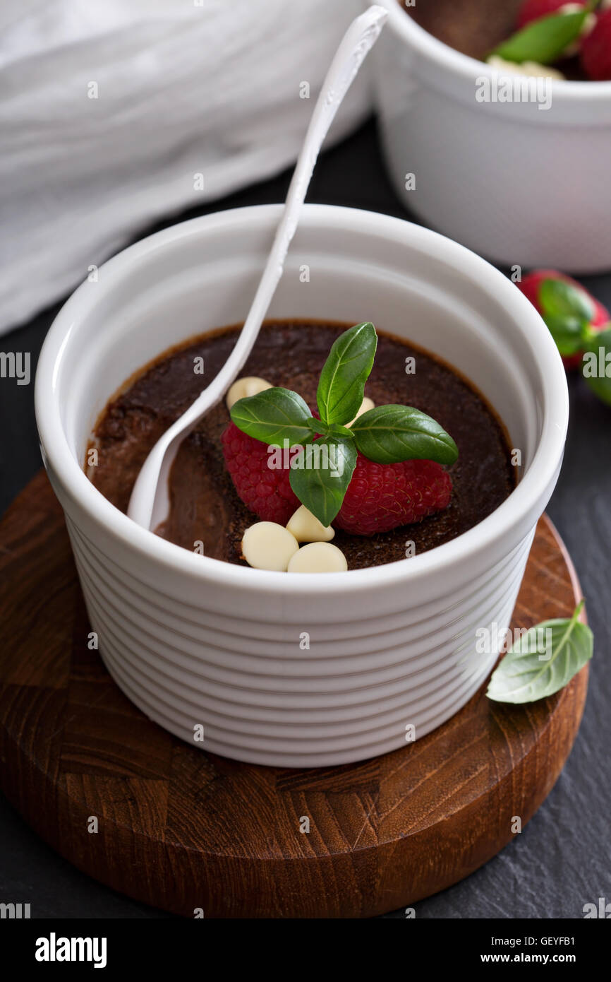 Chocolate pudding with raspberries and basil - Stock Image