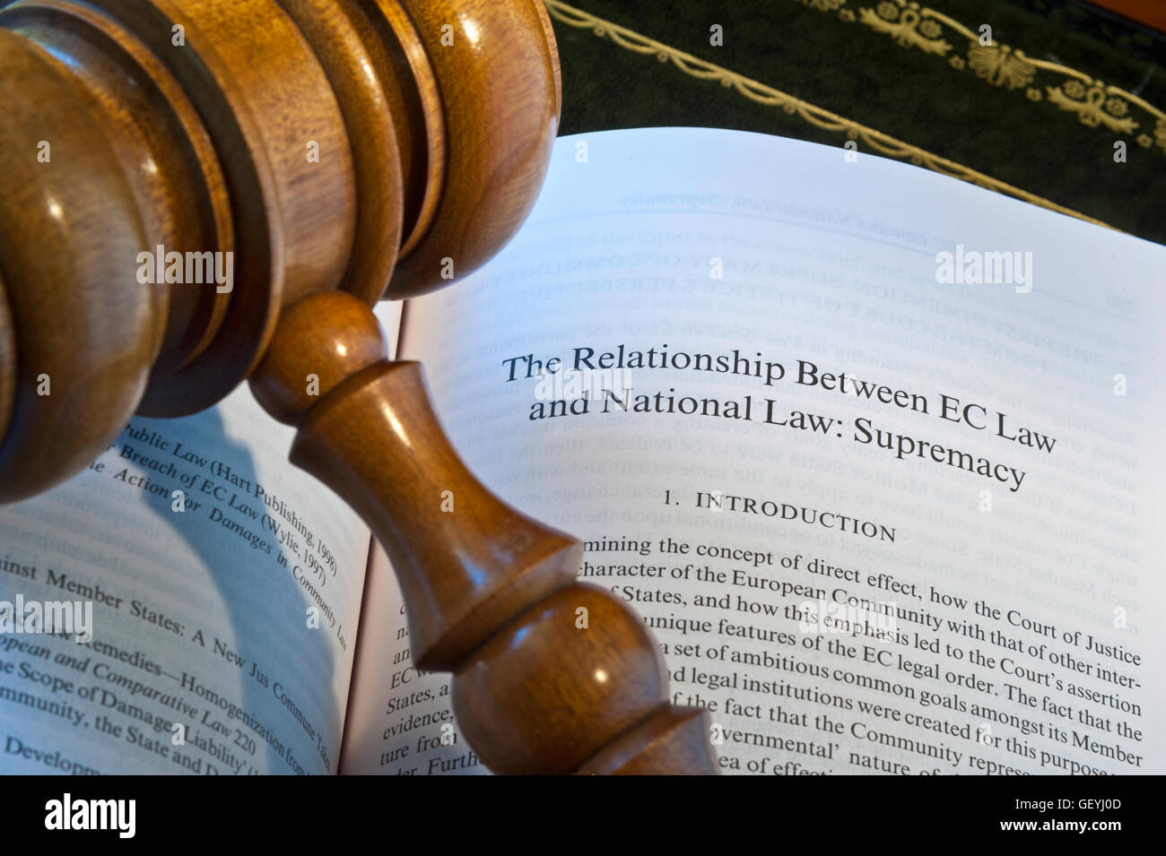 BREXIT Concept image of open EU reference Law book on desk with judges gavel on page reference to EC Law & National - Stock Image
