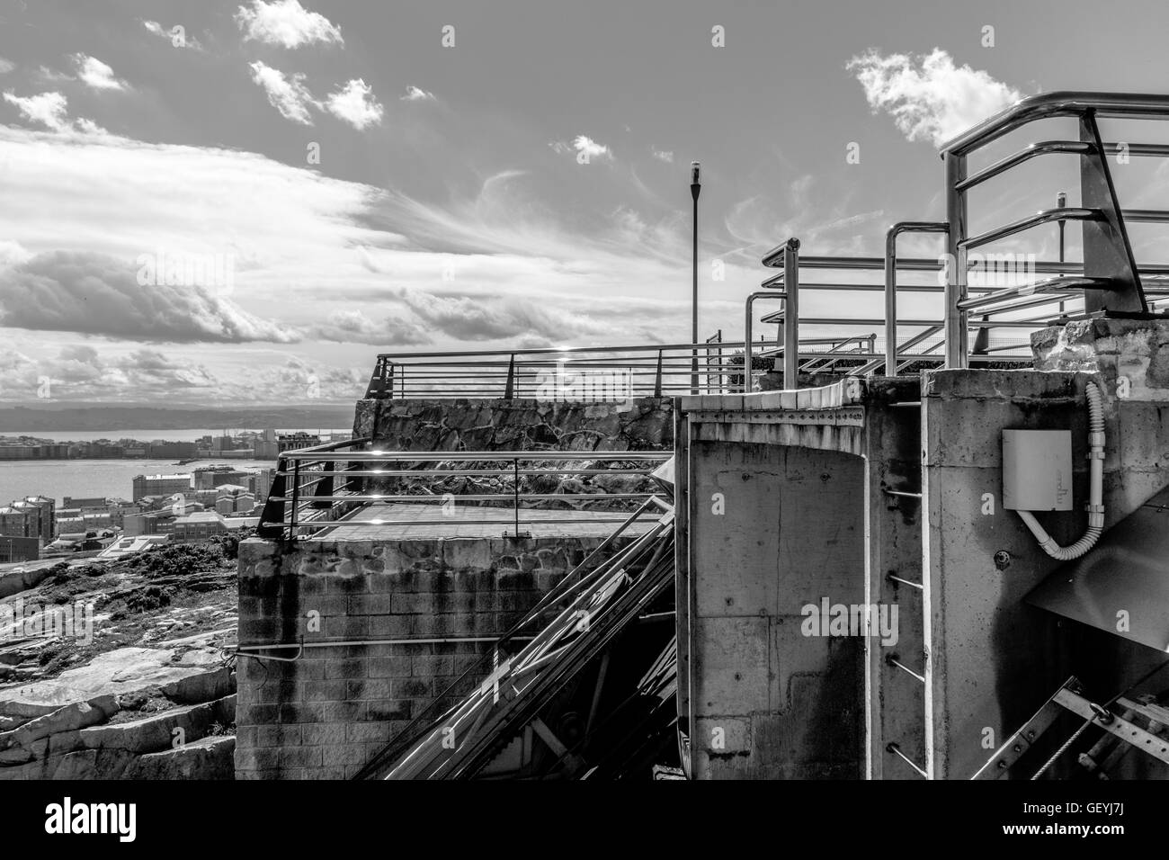 Close-Up Of Industrial Installation Against Cloudy Sky - Stock Image