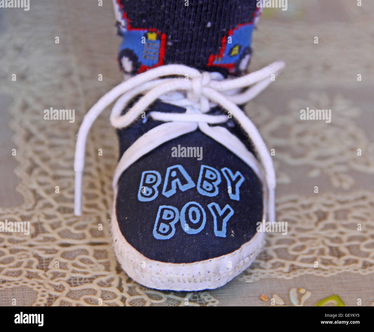African baby boy's left foot and shoe, Pretoria, South Africa. 2012/12/15 Stock Photo