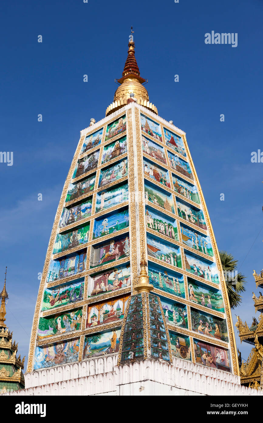 Inspired by the Indian Mahabodhi temple, the column of Buddha in the Shwedagon Pagoda area, at Yangon (Myanmar). - Stock Image