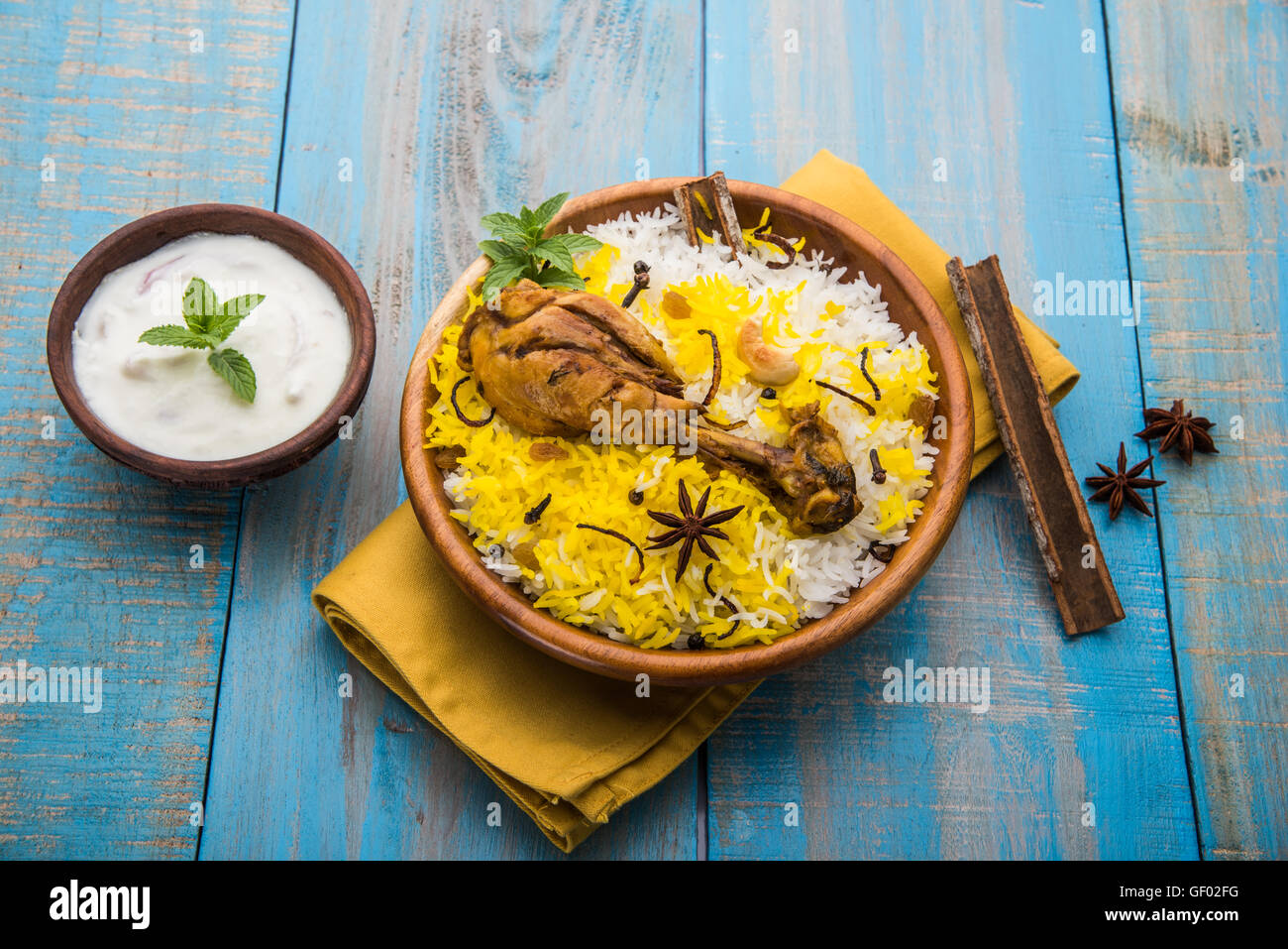 Indian non veg dish stock photos indian non veg dish stock images chicken biryani with yogurt dip on beautiful moody background selective focus stock image forumfinder Images