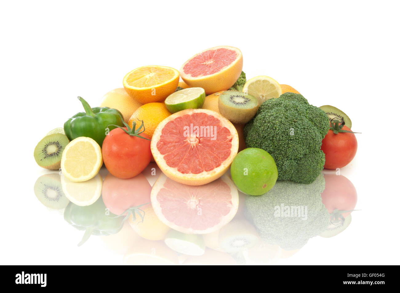 Selection of fruits and vegetables high in vitamin C over a white background - Stock Image