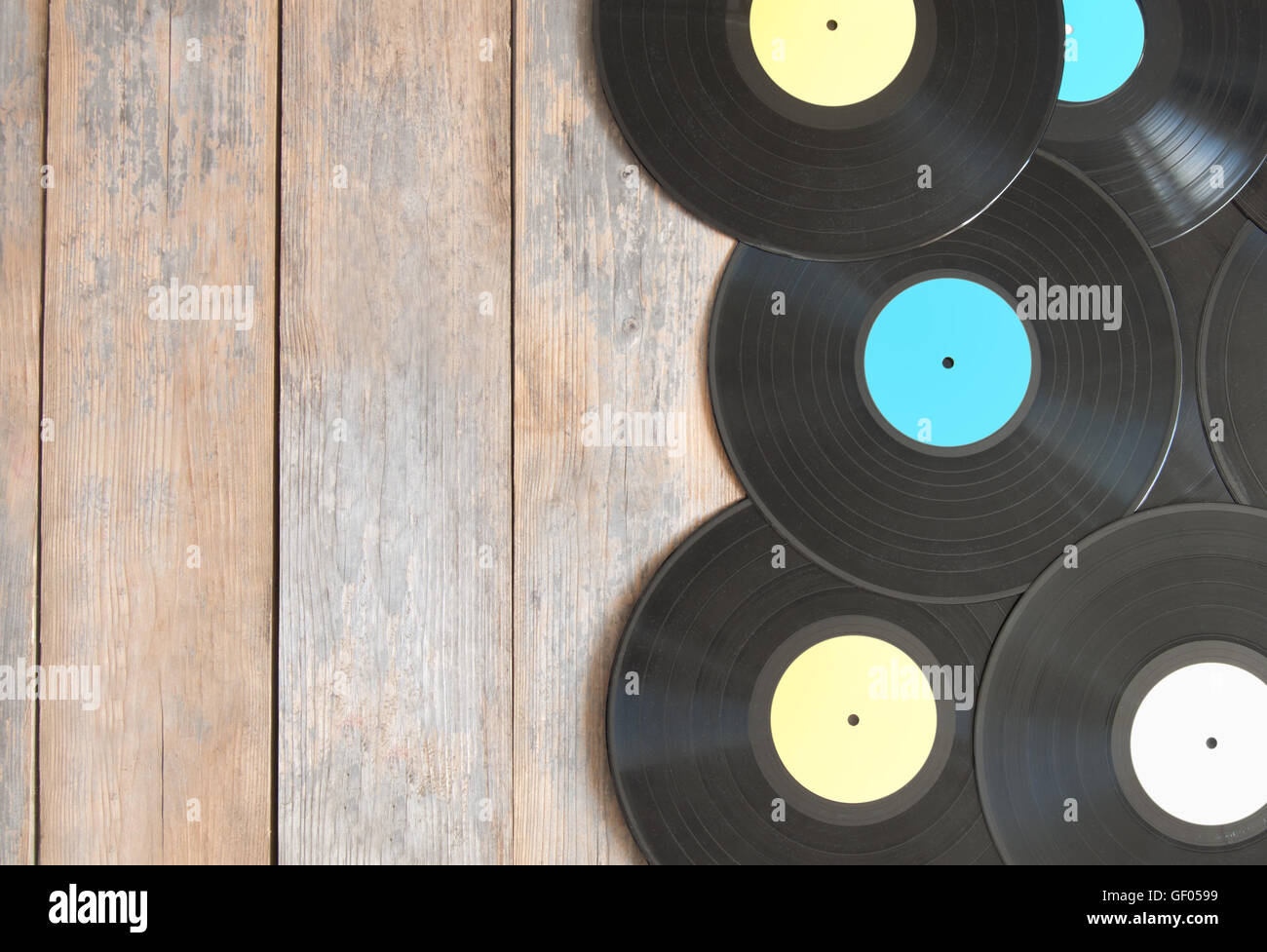 Vinyl Records On Top Of Wood With Space Stock Photo