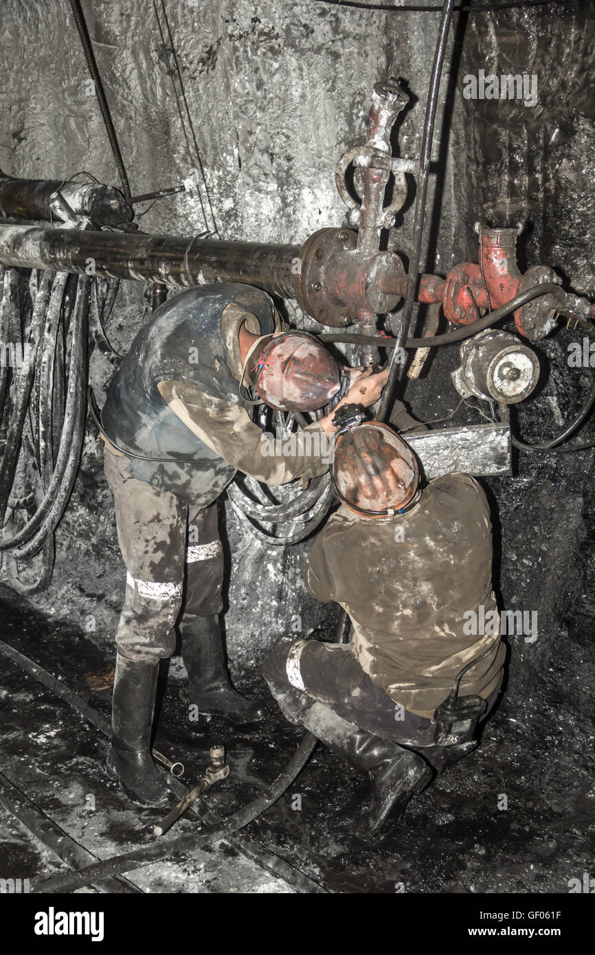 miner performs work in a mine - Stock Image