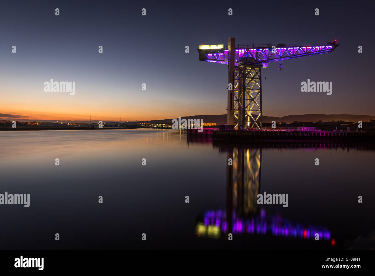 One of the few remaining Titan cranes remaining in Scotland, reflecting in the River Clyde at Clydebank - Stock Image
