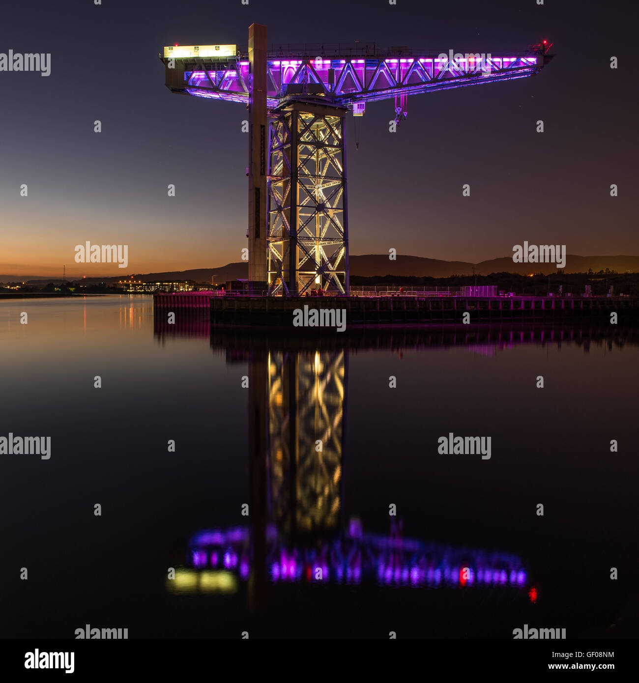 Reflections of the Titan Crane on the River Clyde at Clydebank in Scotland - Stock Image
