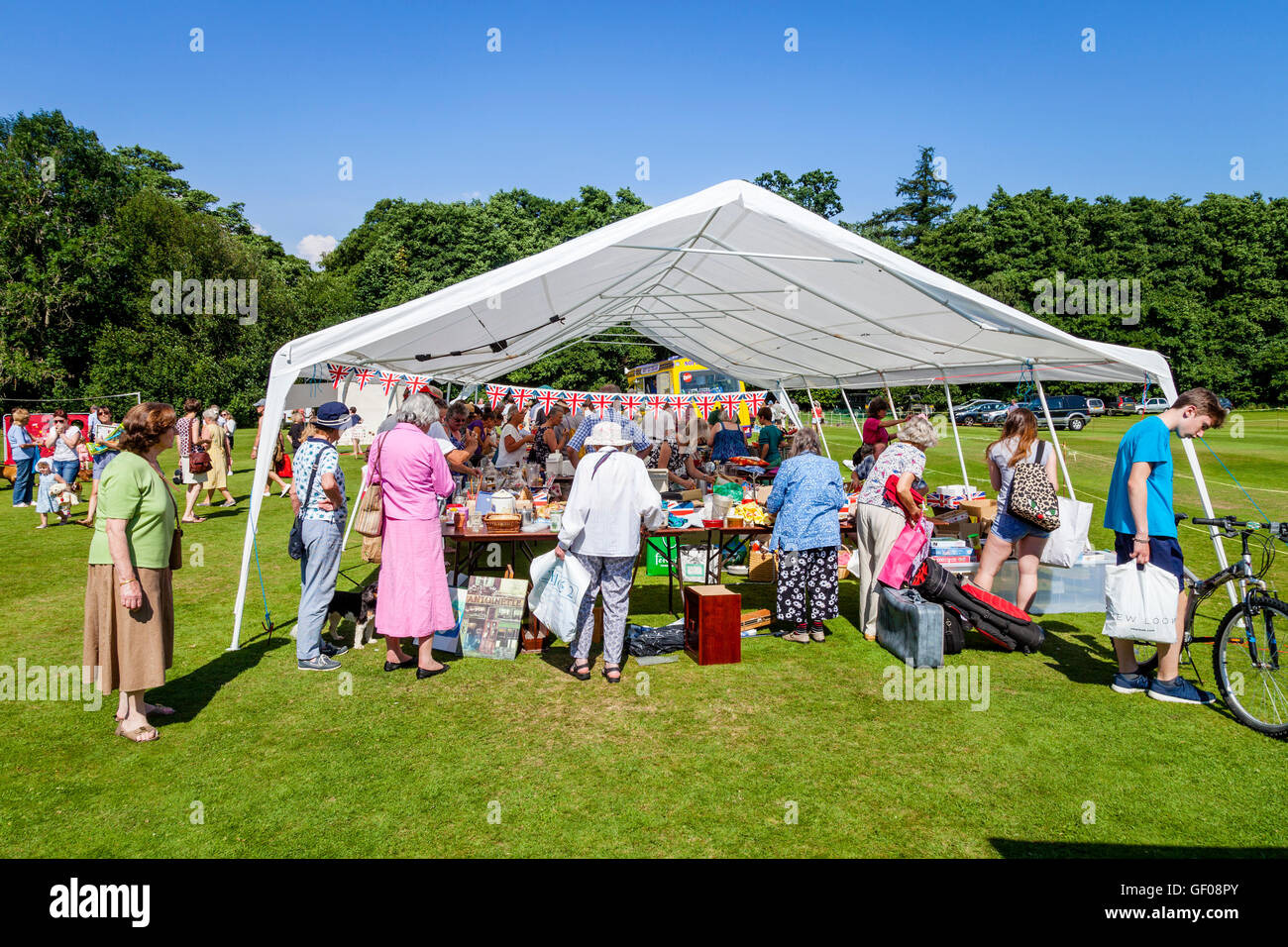 Local People Browsing/Buying From A Bric A Brac Stall, Withyham Fete, Withyham, Sussex, UK - Stock Image