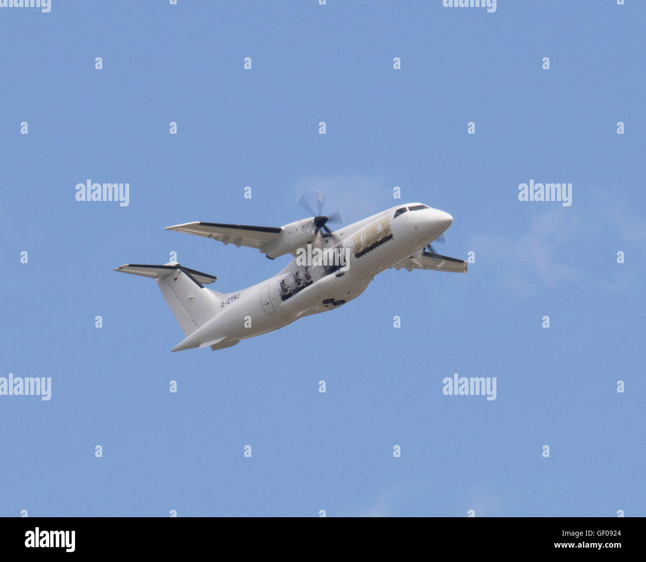 Dornier 328 twin turbo-prop aircraft registration D-CTRJ flying at