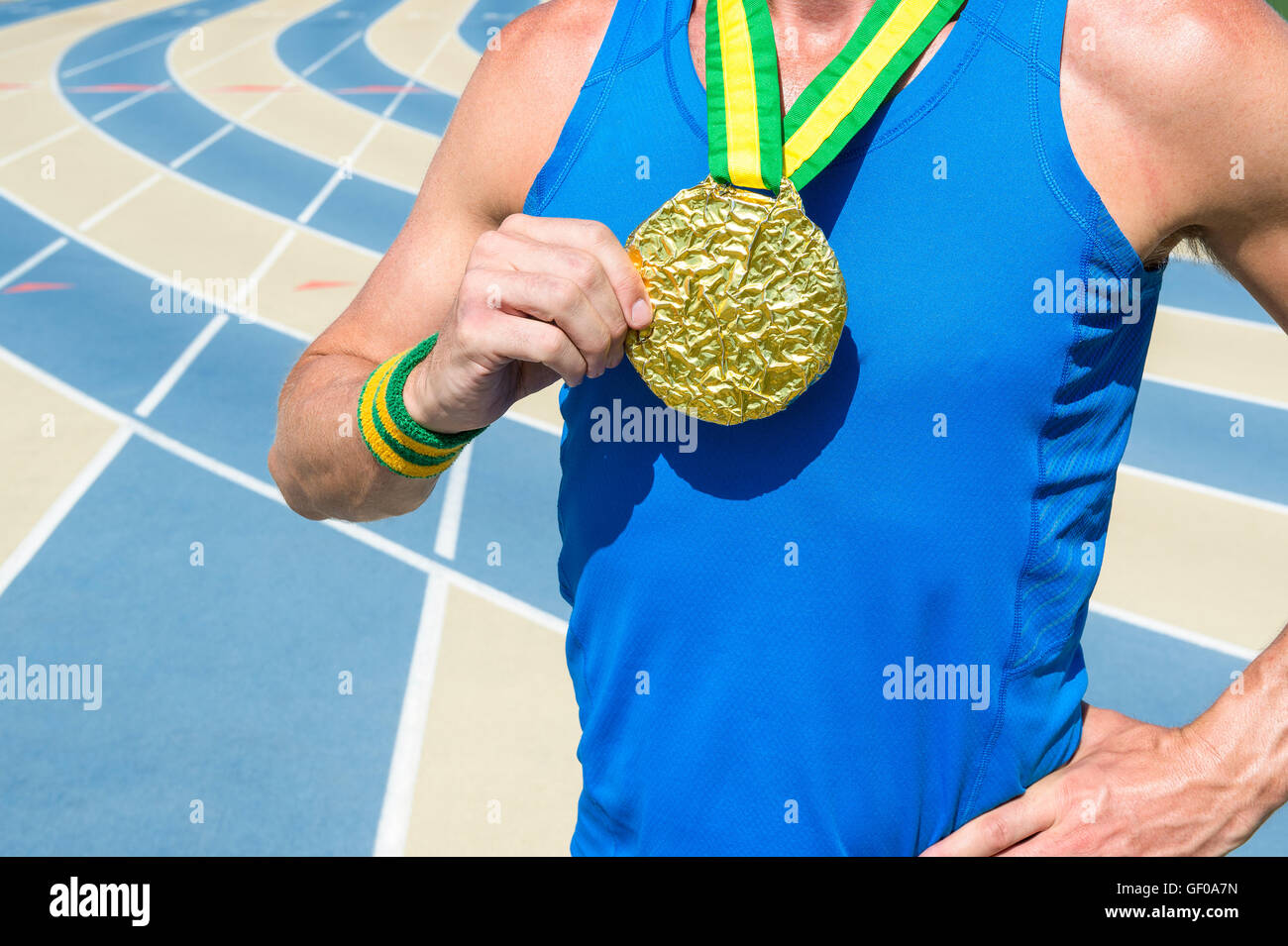 Brazilian athlete standing with gold medal on Brazil colors