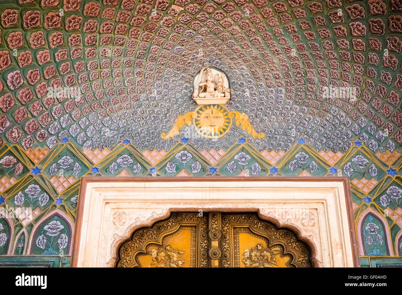 Ornate gateway and gate  at Chandra Mahal, one of the palaces in Jaipur's City Palace, Rajasthan, India. - Stock Image