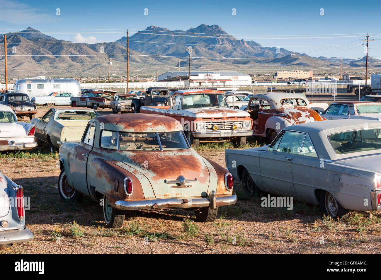 rusty classic american cars in a junkyard near Kingman, Arizona USA ...