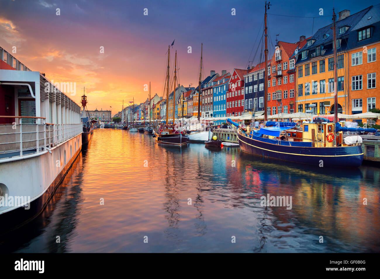 Copenhagen, Nyhavn Canal. Image of Nyhavn Canal in Copenhagen, Denmark during beautiful sunset. - Stock Image