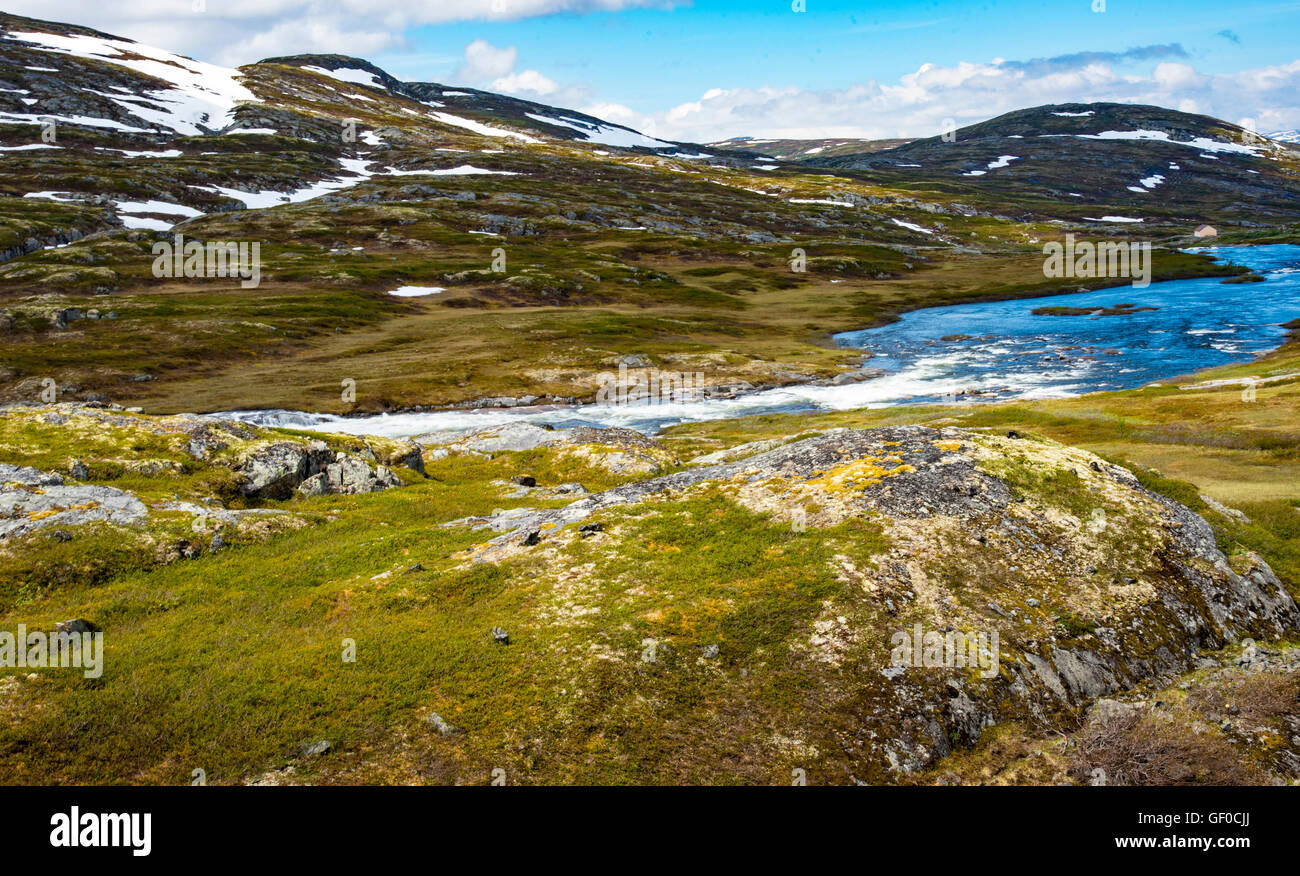 River flowing over waterfalls in Springtime, Hardangervidda National Park, Norway, Hordaland, Scandinavia, European - Stock Image