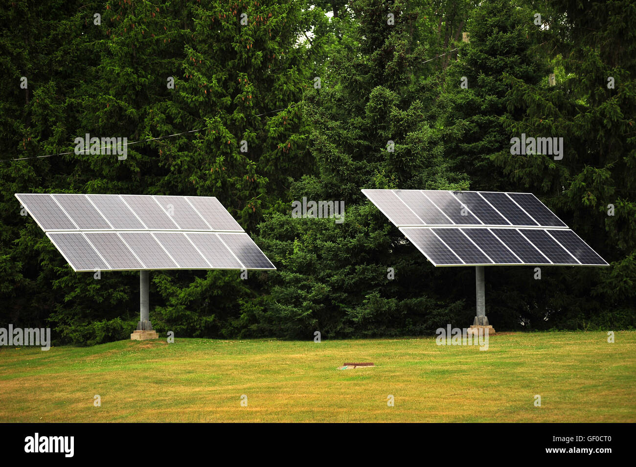 Renewable solar energy panels on the outskirts of the Canadian city of London, Ontario. - Stock Image