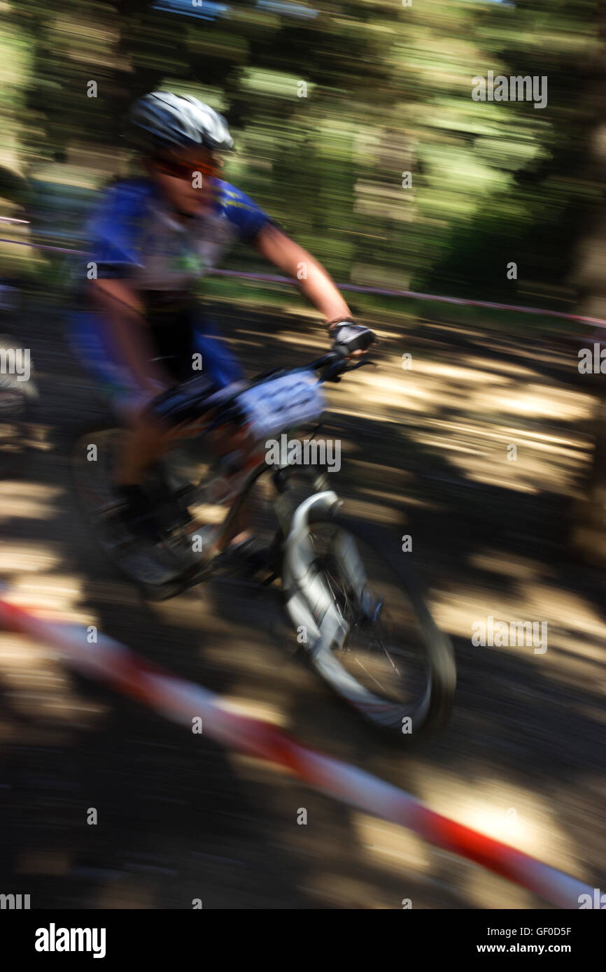 Young MTB biker pedalling at Bike & FUN CUP 2016, with camera panning blurry background. Seih sou forest, Thessaloniki, - Stock Image