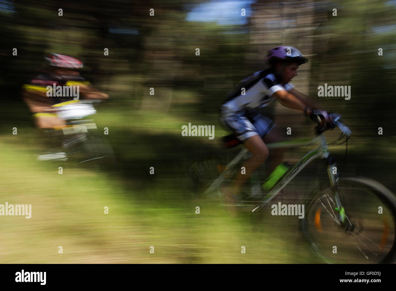 Young MTB cyclists with camera motion panning blurry background light streaks. Seih sou forest, Bike and fun 2016, - Stock Image