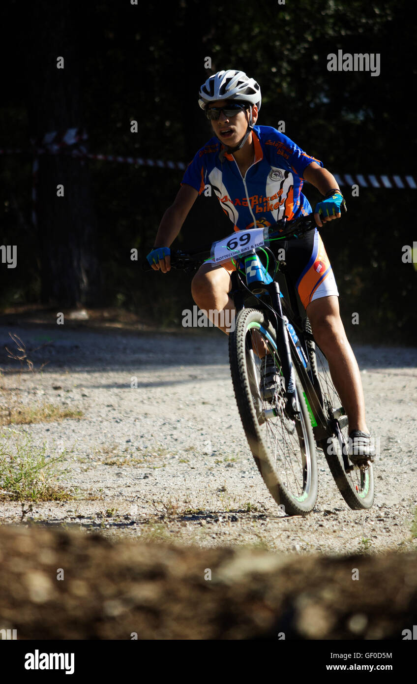 Velos cycling club biker turning at the BIKE and FUN CUP, Seix sou (Seih Sou) forest, Summer 2016, Thessaloniki, - Stock Image