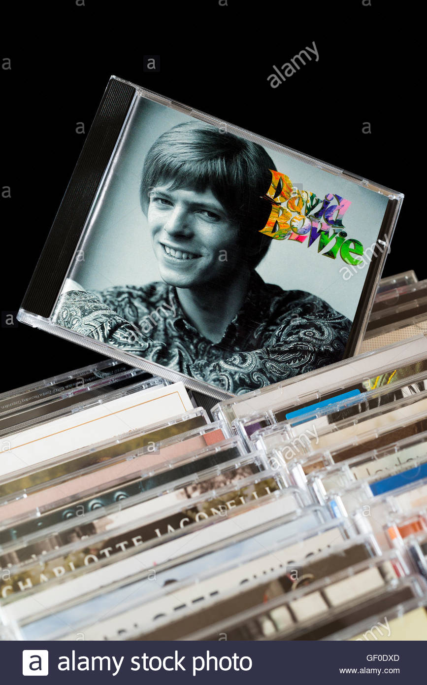 David Bowie CD pulled out from rows of other CD's Stock Photo