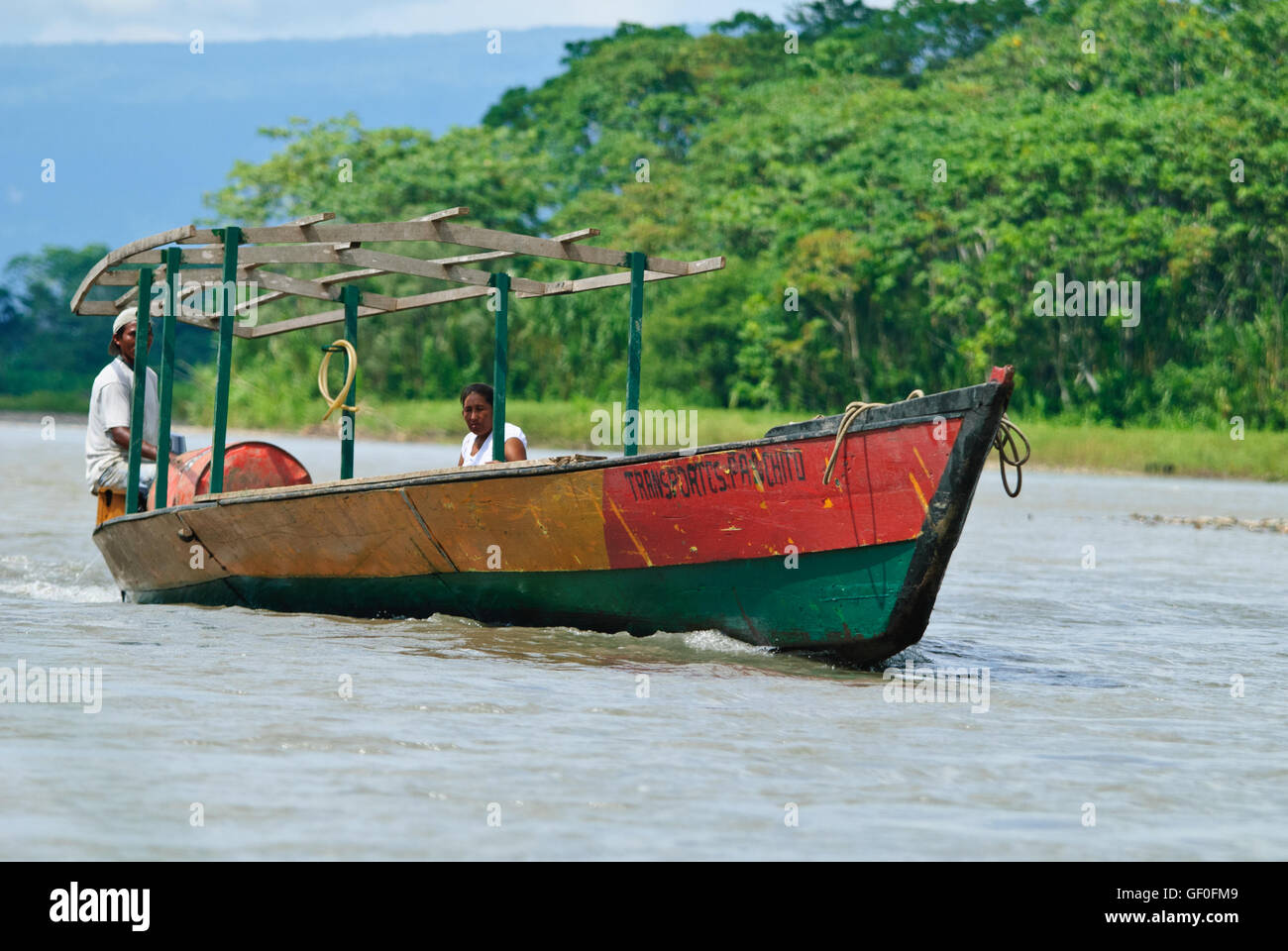 Local people on a boat travelling along the Manu River - Stock Image