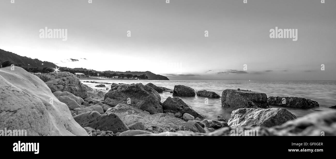 Water and rocks. Sea landscape in black and white - Stock Image