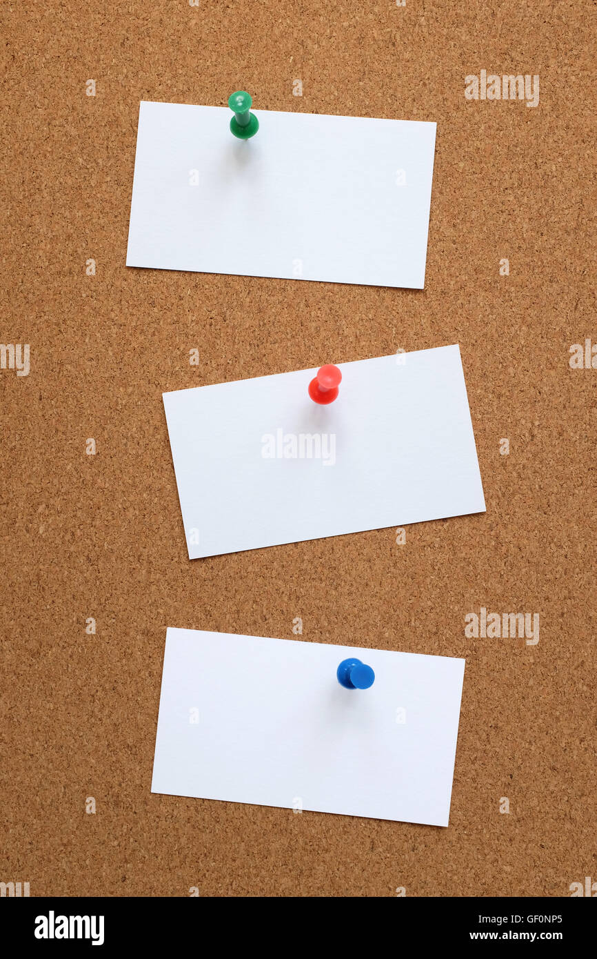 Three blank business cards pinned to a cork pin board Stock Photo ...