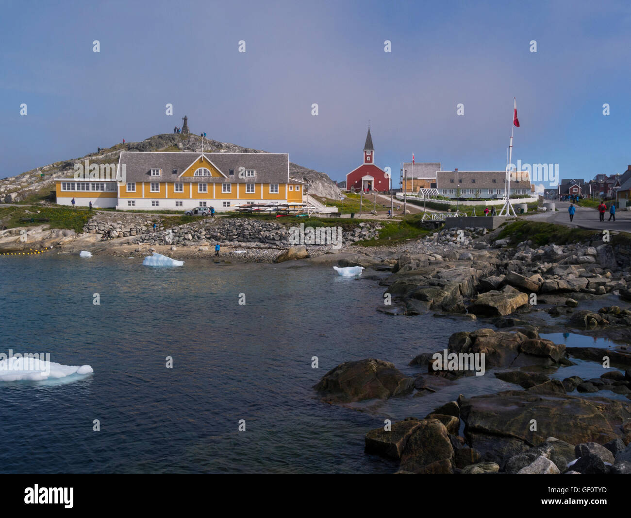 View across Sissiugaq bay to Our Saviours Church and Hans Egede Statue Old colonial district Nuuk Greenlands capital Stock Photo