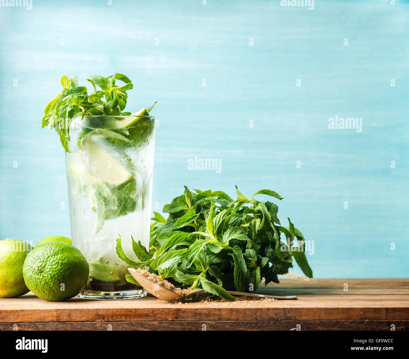 Homemade Mojito cocktail in tall glass with mint, brown sugar and limes. Stock Photo