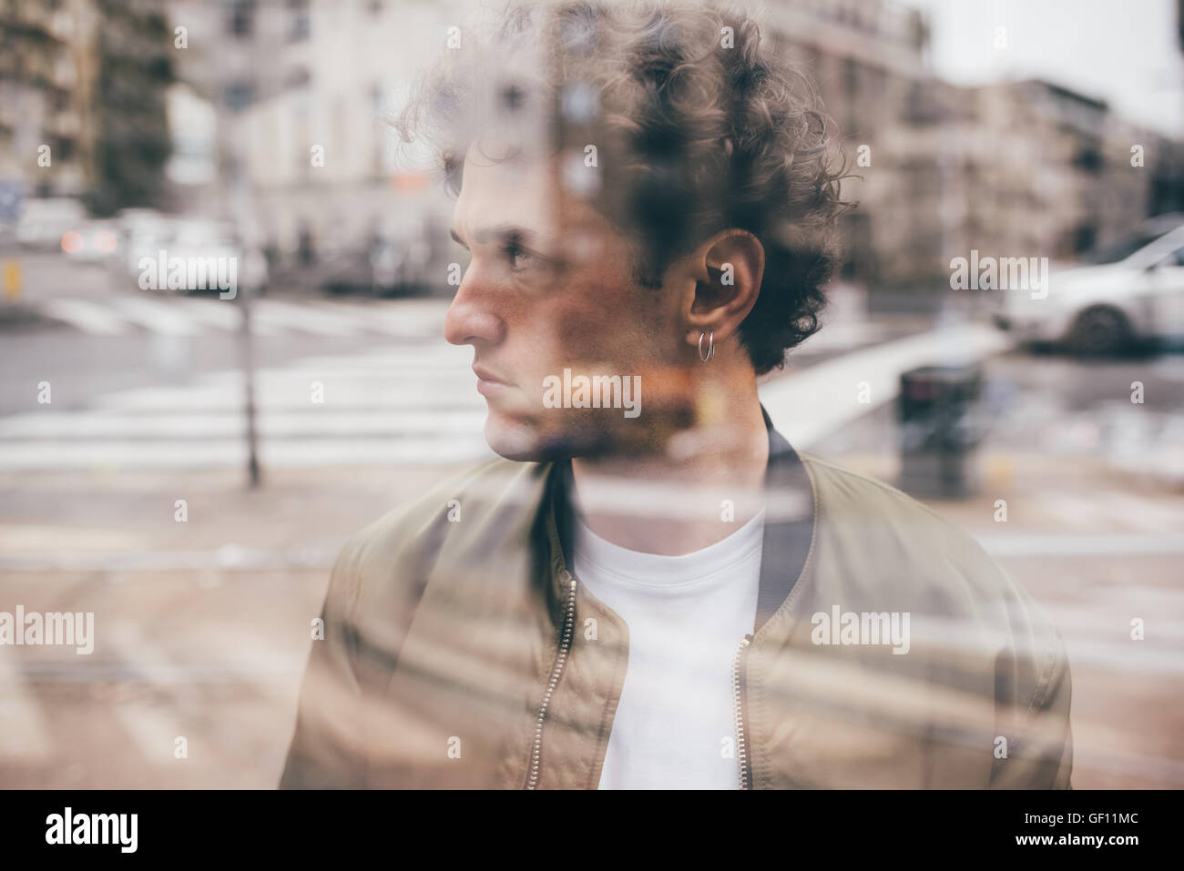 Half length double exposure portrait of young caucasian brown hair bearded man. - Stock Image
