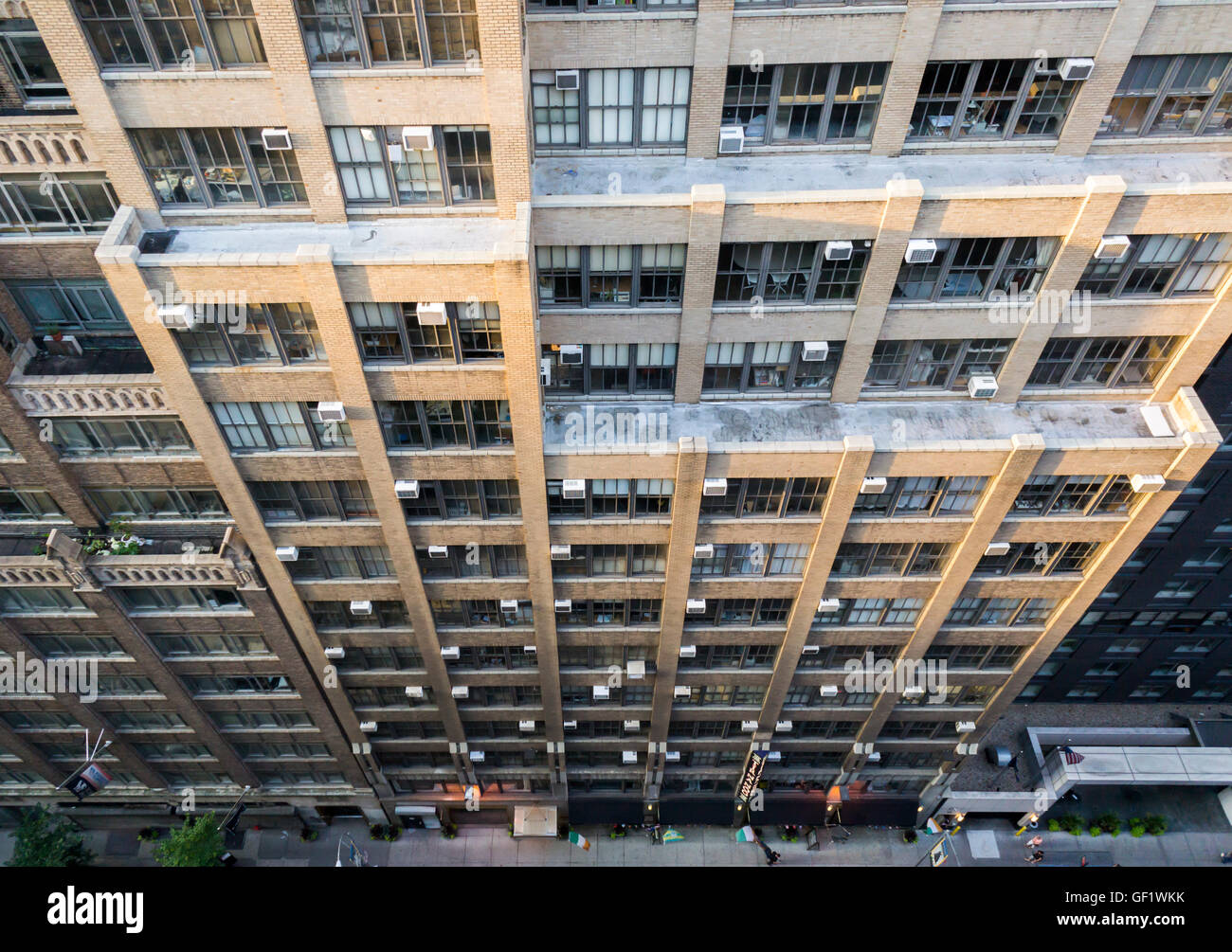 Air conditioners sprout from windows in an office building in New York on Thursday, July 21, 2016. The city has - Stock Image