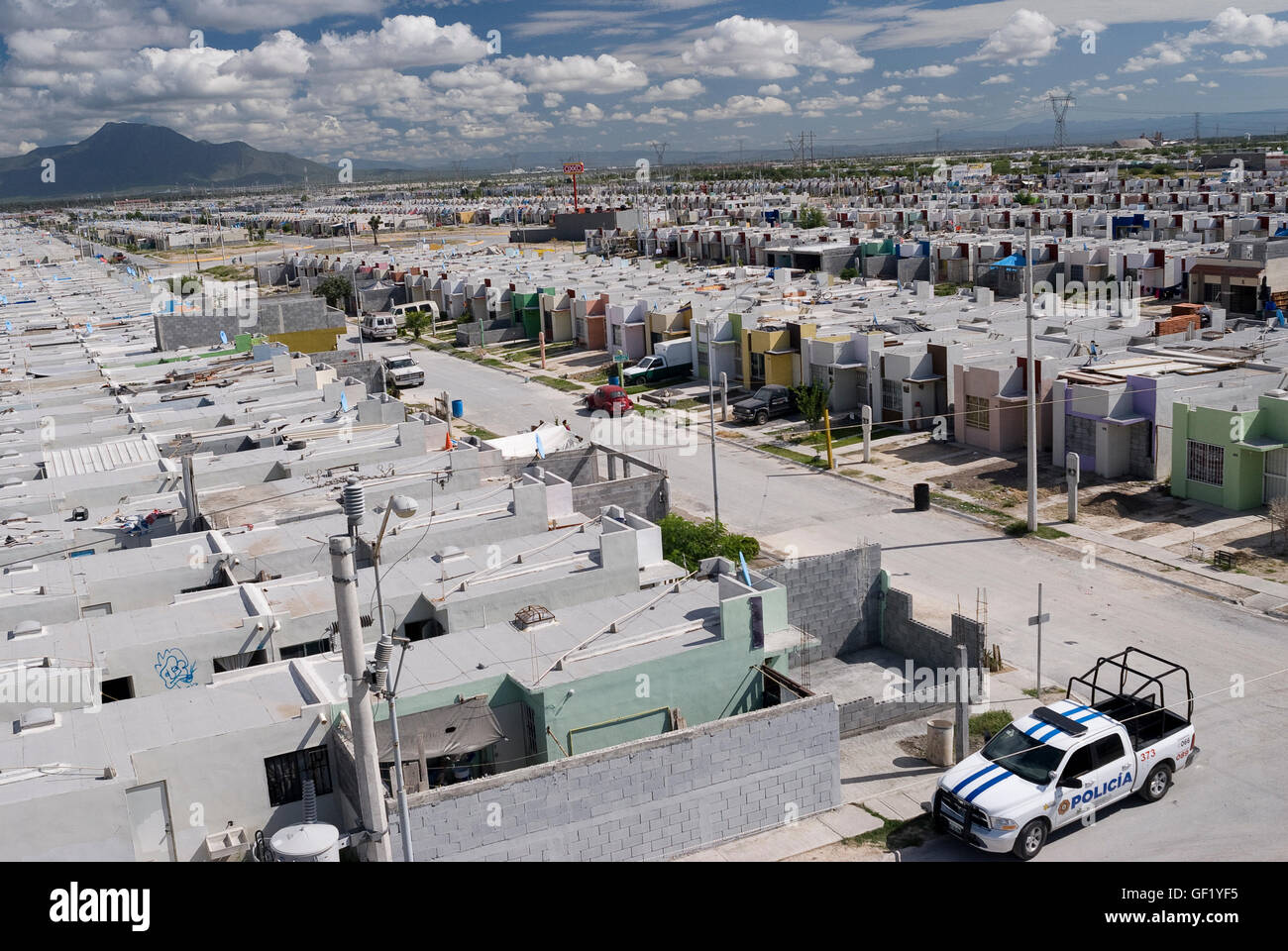 Police patrol low-cost government housing neighborhood in Colonia San Miguel in Escobedo, Nuevo Leon, Mexico. - Stock Image